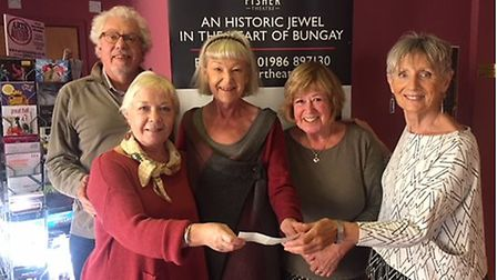 Former Bungay mayor Sue Collins and Jan Hughes presenting a cheque to members of the Fisher Theatre: