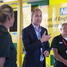 The Duke of Cambridge meets paramedic staff, maintaining social distancing, from the East of England