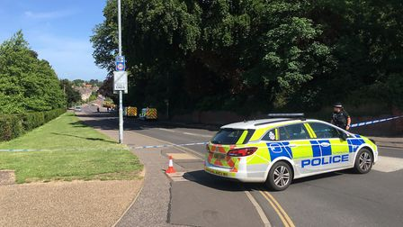 Police cordoned off part of Drayton Road and St Martins Road after a man died in Clapham Wood nearby