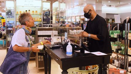 Paris Cressy, personal beauty consultant, serves customer Suzi George as Jarrold reopens after lockd