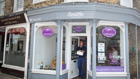The Duke of Cambridge carrying baked goods and pastries as he leaves Smiths the Bakers, in the High