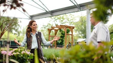 The Duchess of Cambridge talks to Martin and Jennie Turner, owners of the Fakenham Garden Centre in