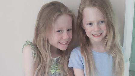 Twin sisters Maisy and Sophia Rounce, seven, from Sprowston, who will get their hair cut - when it i