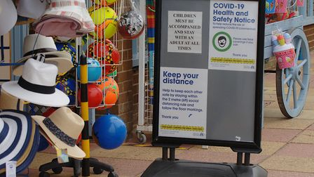Signage outside World of Fun in Hunstanton asks customers to socially distance Picture: Chris Bisho