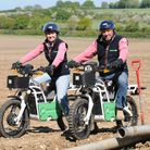 Andrew Mount (right) and Fliss Cleverley of Keith Mount Liming on electric work bikes made by Norfol