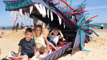 Eddie Lambert, four, front, with Maya Day, five, and Elliott Barnard, four, inside the dragon on the