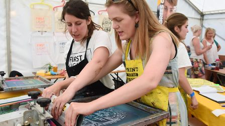 Beverley Coraldean of Print to the People teaches Annette Pierson, right, how to print a t-shirt at