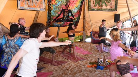 Yoga in the Well-being by the Waves wigwam at Lowestoft's First Light Festival. Picture: DENISE BRAD