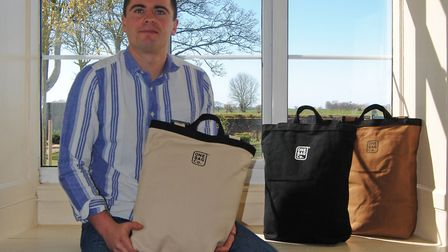 Ben Rossi with backpacks he has designed for his business The One Bag Company