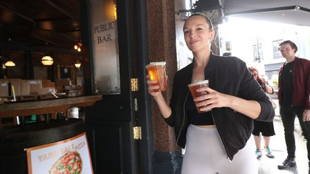 Customers are served takeaway drinks from the Cat & Mutton pub in London over the weekend. In a fort