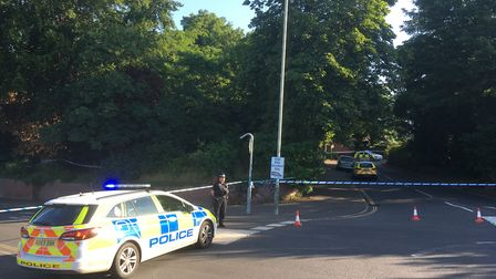 The road closure at St Martins Road after a man died in nearby Clapham Woods. Photo: Archant