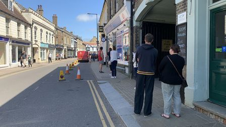 People followed social distancing guidelines as they queued for the Downham Market Post Office. Pict