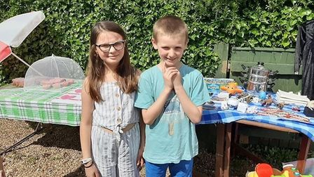 Lucy and Benjamin Townshend raised more than £100 with a yard sale. Picture: Priscilla Bacon Hospice