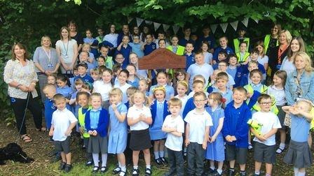 Scole Primary School pupils and teachers at the opening of the new woodland classroom at Scole Pocke