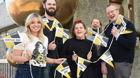 Norfolk Day merchandise includes bunting and flags. From left, Abbie Smith, Ben Craske, Abigail Nich