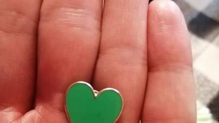 Dozens took part in a clap for Budgens staff in Holt and made green badges and hearts. Pictures: Kat