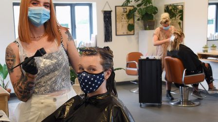 Hannah Allinson, happy to be back as she re-opens her hair salon, Unit 7, to clients at Heydon. With