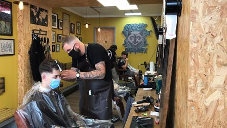 Clients had their hair cut at The Wolfpack barber shop for the first time since lockdown. Photo: Kan