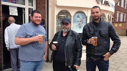 Regulars of the Coach Makers Arms enjoying a pint outside one of their favourite pubs for the first