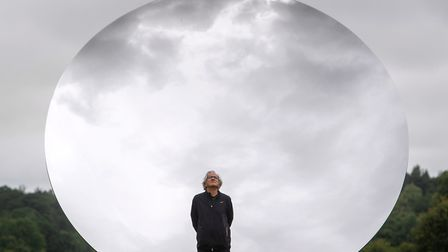 Artist Anish Kapoor stands in front of 'Sky Mirror' at Houghton Hall, King's Lynn, ahead of the open