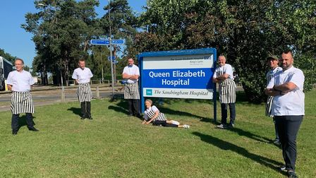 Charlie Hodson (R) and his team, who have taken over the kitchens at the Queen Elizabeth Hospital in