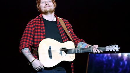 Ed Sheeran performing on the Pyramid Stage in 2017