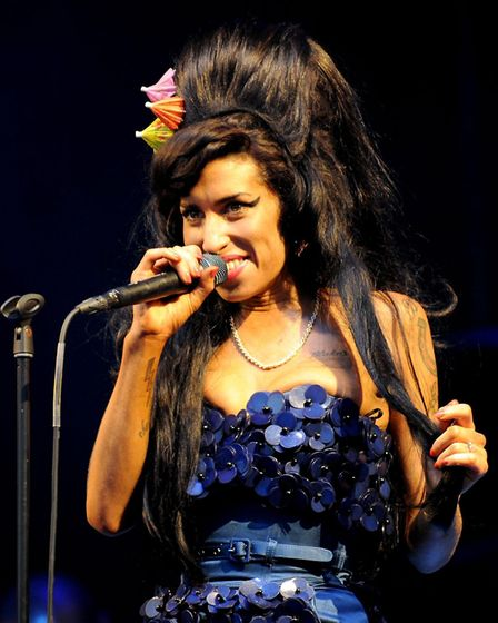 Amy Winehouse performing on the Pyramid Stage during the Glastonbury in 2008