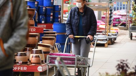 A customer wears a face mask at Thetford Garden Centre during the Coronavirus lockdown. Picture: DEN