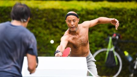 Table tennis players enjoying a game in the sunshine at Eaton Park in Norwich. Picture: Ian Burt