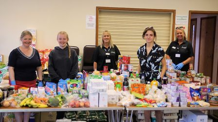 Some of the team behind the Wymondham Community Outreach Project emergency food service at their bas