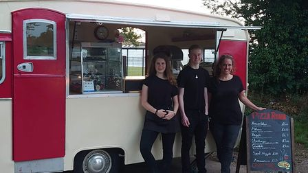 Julia Kirby with her children Cameron and Bonnie at the new Pizza Roma van which is touring Norfolk