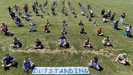Pupils and staff at Carlton Colville Primary School in Lowestoft, celebrating being rated as 'Outsta