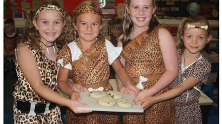 Pupils at Carlton Colville Primary School in Lowestoft, celebrating being rated as 'Outstanding' onc