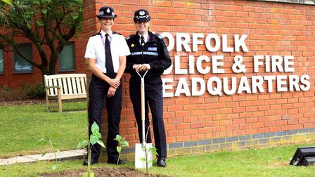 Assistant chief constable Julie Wvendth (right) and Inspector Lucy King planting sunflowers at Norfo