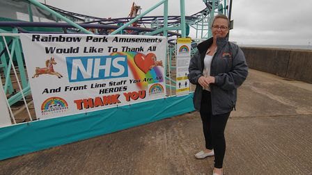 Colleen Roper, with a banner thanking the NHS at Rainbow Park Amusements in Hunstanton Picture: Chr