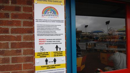 A sign advising visitors of safety measures in place at Rainbow Park Amusements in Hunstanton Pictu