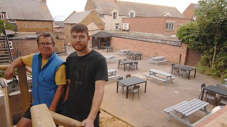 Giles Norwood (left) and Toby Hewitt on the stairs to the new sun terrace, with the beer garden belo