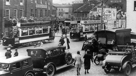 A busy day at the bottom of Timber Hill in old Norwich. Photo: Mike Adcock Collection