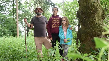 Iain Robinson in the woods he owns, part of woodland near Ringland, which will be affected if the we