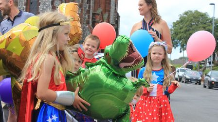 People, many dressed in superhero costumes, lined the streets of Cromer for the funeral procession o