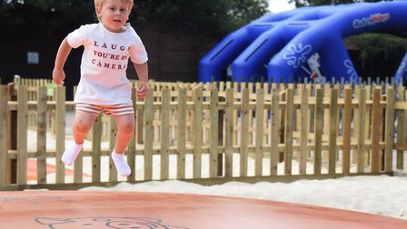 Jumping for joy, three-year-old Arlo Stuttle tries out one of the new attractions, Jumping Pillows,