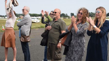 Jack Jenner-Hall's mum, Erin Hall, right, cheers with family and friends as he becomes the youngest