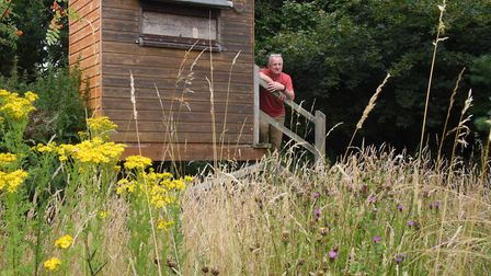 Alan Burgess at his bird hide in his wildlife oasis at Gimingham, where he has re-wilded former farm