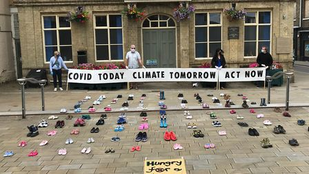 Environmental activists laid out hundreds of children's shoes in Downham Market and King's Lynn to p
