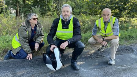 Abby Stancliffe-Vaughan, Ieuan Evans and Nick Moran, assessing the state of the tarmac on the A1066,