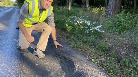 Nick Moran, Thetford cyclist, assessing the state of the tarmac on the A1066, from Thetford to Diss,