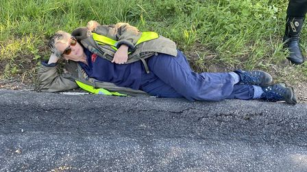 Abby Stancliffe-Vaughan, from Thetford, assessing the state of the tarmac on the A1066, coming out o
