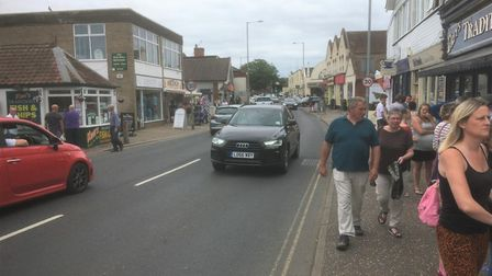 Busy high street in Wroxham but businesses say trade is half of normal. Picture: Simon Parkin