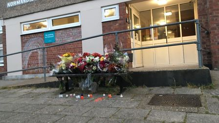 Floral tributes to Craig Stubbs which have been left at Normandie Tower in Norwich. PIC: Peter Walsh