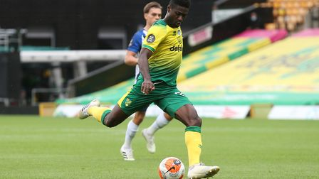 Alexander Tettey of Norwich has a shot on goal during the Premier League match at Carrow Road, Norwi